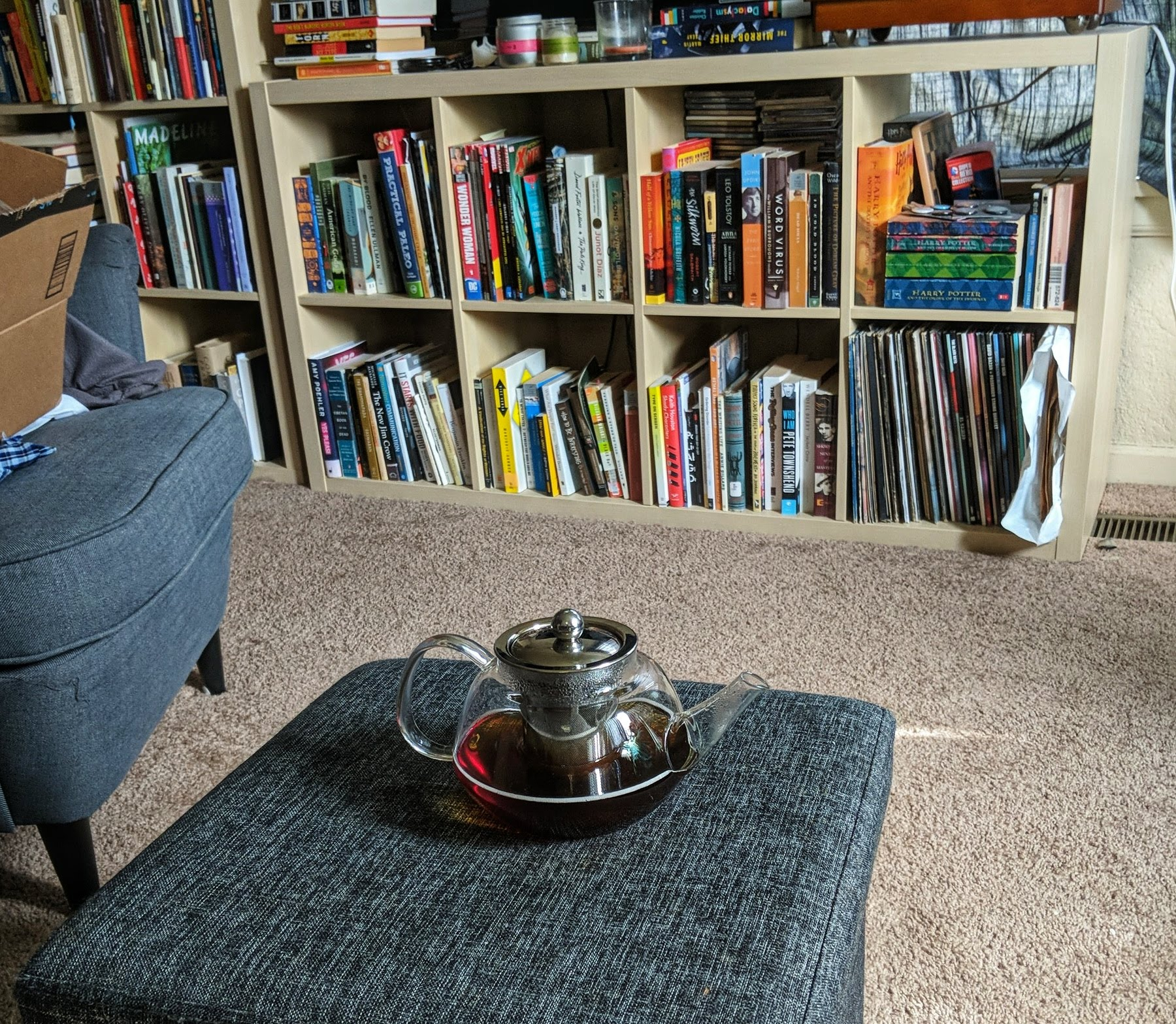 Pot of tea in front of bookshelf